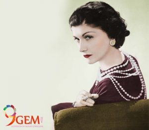 Coco Chanel Wearing Pearl Jewelry